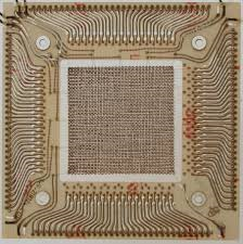 REsembling a weaved cloth, magnetic core memory.